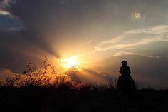 Riding into the Sunset (Jay Tilston) Tags: sunset arizona sky hat silhouette skyline clouds cowboy desert az sunburst cowgirl outline rider horseback justclouds mywinners platinumphoto