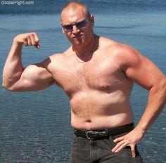 hairy dad flexing beach