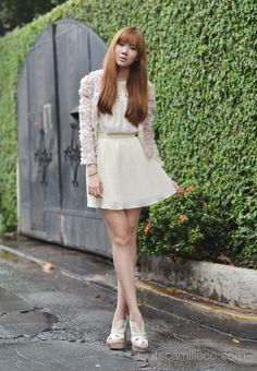 Rosette jacket + lace top + pleated skirt. Such a girlish look.