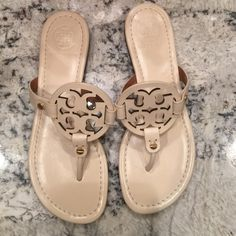 Tory Burch Miller Sandal These are a cute limited edition white leather Tory Burch sandals. They have a lining/rubber sole. They have never been worn. Tory Burch Shoes Sandals