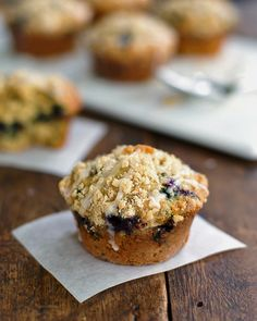 These oatmeal flax blueberry muffins are so simple and stunning with a crumbled topping and a drizzle of glaze. 220 calories per muffin!