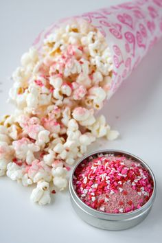 Paper cone filled with gourmet popcorn + sugary sweet pink sprinkles as a topping - Movie night!