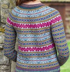 WE LOVE the colour palette Mary Henderson has put together for her intricate cardigan. Bands of Fair Isle feature OXO and heart motifs, as well as delicate 'peerie' patterns. Colourful corrugated ribbing is used at the hem, cuffs and neckline, while the button bands are worked in single-colour moss stitch. The cardigan is knitted in the round, incorporating steek stitches which are then cut and reinforced with crochet. It's worked in Blacker Yarns' new Tamar Lustre Blend wool, which has a…