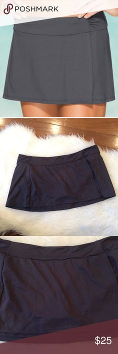 """Athleta Sporty Shirred Swim Skirt Has an ultra-comfortable wide waistband. A great bottom to match with a variety of tops. Condition: gently worn but in near perfect condition. Approx measurements: length: 11"""" waist: 17 1/2""""B:3 NO TRADES OR MODELING Athleta Swim"""