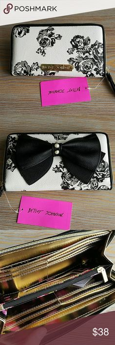 Betsey Johnson Floral Bow Wallet NWT Adorable Betsey Johnson wallet with tag. Has plenty of inside pockets for cards, cash, etc. Even a cell phone fits. Floral colorful pattern inside!  Make an offer of what you find fair if you love it ! Ill do my best to make a deal 💘 Betsey Johnson Bags Wallets