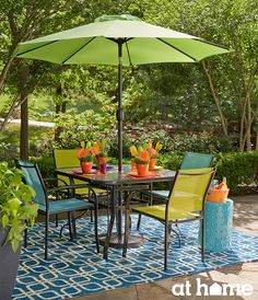 These shades of teal, lime green and orange in this outdoor living ensemble can put a fun, pop of color in your own backyard! #athomefinds