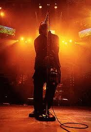 Image result for liam gallagher singing into mic