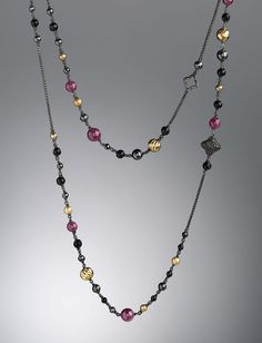 "David Yurman-Bijoux-web-May.2013,•Sterling silver and 18-karat yellow gold quatrefoil necklace. •Ruby, hematite, black onyx, and pave black diamonds; 1.05 total carat weight. •48""L; can be worn doubled."