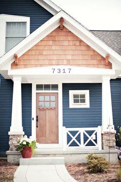 "Our Craftsman Beach House Stacked stone base pillars, transom over door, Hardie Board (Sherwin Williams ""Naval""),cedar shingles, iron lockset, numbers, doorbell"