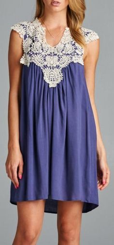The perfect dress for any occasion. Features flat collared lace detailing in front. Fully lined. 100% Rayon.