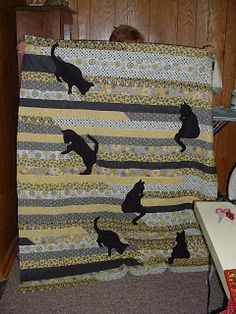 Bonnie's Cat 1600 Quilt by Bonnie and Donna W. posted by quiltingwithmarmaladecat.blogspot.ca in Oct 2011 - Jelly roll race quilt with cats