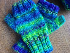 Made these with some of my first handspun. Plan was to gift them but we bonded. R&S Creations hand dyed BLF superwash wool.  Ravelry: doodlebeck's Handspun BFL mitts o'love