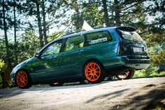 Green Ford Focus mk1 before facelifting with TN1 orange rims!