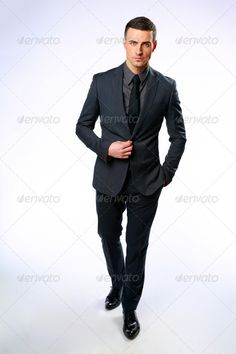 Full-length portrait of a confident businessman standing over gray background ... Looking At Camera, arms, boss, business, businessman, casual, caucasian, company, confident, consultant, contemporary, corporate, employee, employer, entrepreneur, executive, formal, full, full-length, gray, handsome, human, isolated, job, length, male, man, manager, modern, office, one, person, professional, representative, secretary, single, smart, standing, stylish, success, successful, tie, work