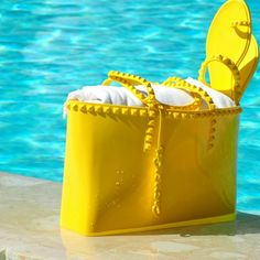 Summer is all about beautiful briht colors  #yellow #summer #carmensol #beach #summertime #summerwear #beachaccessories #sandals #jelly #totebag #totes #grabbag