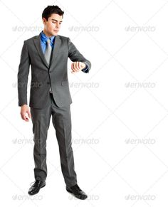 Businessman checking the time ...  alarm, business, businessman, checking, clock, concept, deadline, employee, executive, full, handsome, hour, hurry, isolated, late, length, male, man, manager, office, people, person, professional, punctual, punctuality, smart, success, successful, time, white, work, worker