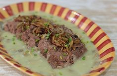 My recipe for ox tongue (lengua) in mushroom sauce is topped with caramelized onion and served with mashed potatoes on the side. Party perfect!
