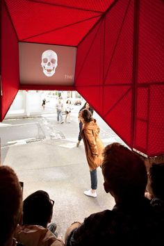 Oh.No.Sumo's temporary cinema is at the intersection of Symonds Street and Mount Street is a place of 'hard waiting'. Bus stops and laundromats create a hard-scape of poor space for social interaction. Members of the public retreat individually into the media offered on their mobile phones. This in turn results in greater separation and dislocation from an existing community that is waiting to be activated. A community must be linked not only virtually but also physically.