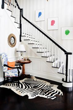 Black and white foyer with zebra hide and silhouette prints.