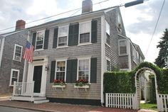 Nantucket is the quintessential American summer town. Get the full New England experience and rent this circa-1850s home (pictured above; complete with shingles, shutters and an American flag!) a block away from Main Street. Click to start planning your trip.   - HouseBeautiful.com