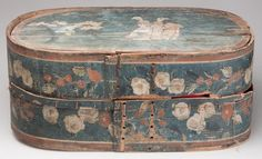"POLYCHROME PAINT-DECORATED PINE BRIDE'S BOX, oval bentwood form, top featuring a landscape comprising three figures and trees with an illegible inscription above, running floral decoration surrounding sides. 18th or 19th century. 9"" H, 14 1/2"" x 21"".     Provenance: The estate collection of Richard and Betty Robertson, Waynesboro, VA."