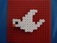 Dove made out of Hama beads. The older primary school children at Messy Church enjoy the Hama beads.