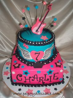 """This cake was based on the """"Rocker Girl"""" party decor and invitation. Cake is WASC, filling is caramel-infused butter cream, icing is traditional crusting butter cream smoothed using the viva method. Starbursts are glued to painted pasta.  Happy birthday, Charlie! Nobody """"parties like a rockstar"""" better than a bunch of 7 year old girls!"""