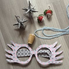 This is my Luna Lovegood DIY collection :) The glasses are made of cardboard, very simple. The necklace is made of tiny beads and a cork, also very simple. I wanted to make her Christmas Earrings from Xmas Decoration and it actually took forever to find the perfect stars. But I think the result is quite cool :) And the Radish/Dirigible Plum Earrings were so tricky. I used wire, beads and two little Fimo Balls to get them right. :)