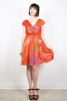 Vintage Orange Dress Midi Dress Rainbow Print by ShopTwitchVintage #vintage #etsy #70s #1970s #hippie #orange #midi #dress #ruffle #scarf