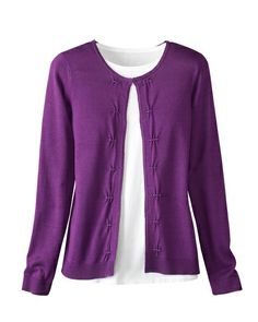 I like the bright plum of this cardi and would pair with a solid bright colored tee.  However, I'd fasten it at the waist rather than at the neck to give it some shaping.