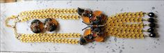 Runway Stanley Hagler N.Y.C. Butterfly Necklace Matching Clip Earrings Glass Beads Extravagant Beauty Fall Colors by EastMountainRelics on Etsy https://www.etsy.com/listing/247058306/runway-stanley-hagler-nyc-butterfly