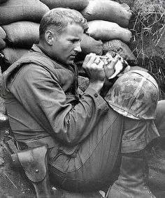 1953. Sergeant Frank Prayton takes care of a two weeks old cat during the War of Korea