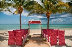 Beautiful, intimate wedding set-up at Blue Diamond Riviera Maya! Perfectly placed between two palm trees. #beachwedding #LGBT #Mexico