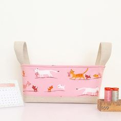 Latest hour basket in Heather Ross' tiger lily fabric for windham fabrics Love the linen with the pink!