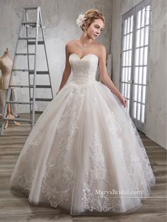 Style 6583, sugg. retail price  $823,00-$905,00      Tulle ball gown with lace appliqués and sweetheart neckline and basque waist. Gown has a zipper back with buttons.  Available in: white, ivory, champagne