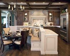 If only above the stove was stone or brick, this kitchen would be perfect! Love the. Table/booth !!