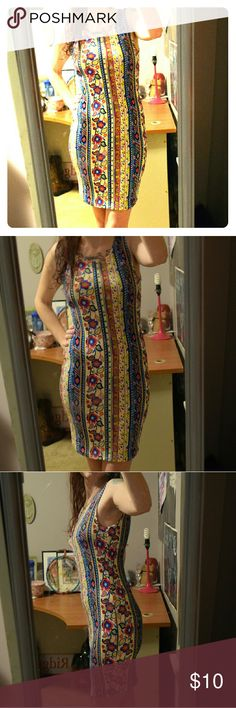 """Floral Pattern Dress Form fitting dress. Really pretty colors and pattern. V's down in back - pictured.  Never worn.  I wear Medium or Large, 8/10, and am about 5' 9"""" - for size comparison. Dresses"""
