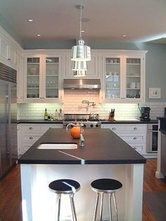 Sometimes, a run-of-the-mill granite with a finish other than a high sheen can make it look altogether new and unusual. The counter shown here is Absolute Black granite with a honed finish. Honed is countertop-speak for matte. Honed finishes on granite make them easier to keep looking clean, and they demand less attention than their shiny cousins.