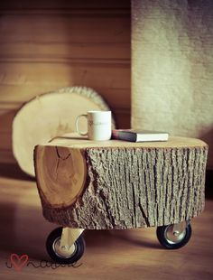 Wooden tree stump on wheels, what a lovely way to bring nature inside in a functional way!