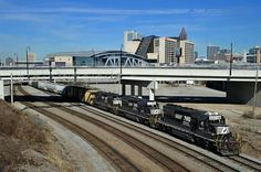 "Piedmont Division local train #P76 passes through control point ""Spring"", former site of the Atlanta Terminal Station."