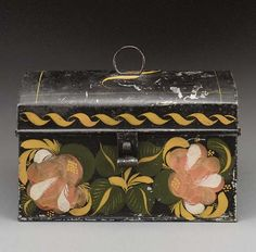 A PAINT DECORATED TOLEWARE DOCUMENT BOX  ZACHARIAH STEVENS, STEVENS PLAINS, MAINE, 1830-1840  5¼in. high, 8½in. wide, 4¼in. deep  with salmon colored flowers