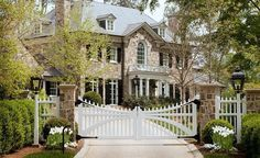 HAMPTONS LIVING: Stone pillars with white picket fences and hedges. Final touch of the white gate with black iron hinges. Take me home....