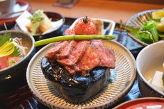 Don't touch: Wagyu beef, sizzling on top of a heated rock, is the main feature of Grand Kitchen Tada's considered maru gozen course meal. Kyoto restaurants