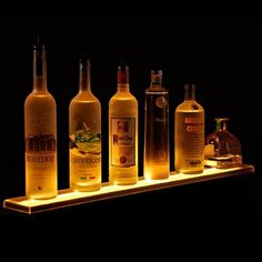 Armana acrylic LED bottle shelf and uplight display. Perfect addition to your home bar, man cave, liquor cabinet, kitchen, or wherever you would like to add functional LED illumination in your home. Bar Shelves, Display Shelves, Liquor Shelves, Shelf, Floating Shelves, Liquor Cabinet, Whiskey Bottle, Vodka Bottle, Bottle Display