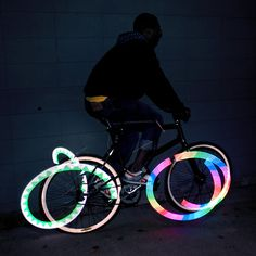 8-Bit Bike Wheel Light - generates thousands of constantly changing patterns and colors, but can be easily adjusted to show just the designs you want
