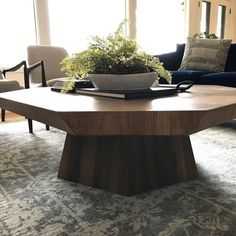Bring the beauty of geometry (with a natural touch) into your modern living room. This unique coffee table features an octagon-shaped top and base with a faceted design in solid wood. Living Room Shop, Living Room Modern, Living Room Designs, Unique Coffee Table, Coffee Tables, Farmhouse Living Room Furniture, Luxury Furniture Brands, Furniture Companies, Classic Furniture