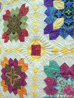The Waiting Room by Diane Hansen, quilted by Judith Kracker. Photo by Quilt Inspiration. Based on Lucy Boston's Patchwork of the Crosses quilt.