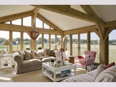 Incredible views in the snug.Modern Country Style: A Stunning Scandinavian/ New England House Tour Click through for details. England Houses, New England Homes, New Homes, Oak Framed Extensions, Oak Framed Buildings, Oak Frame House, Modern Country Style, Modern Country Houses, Country Decor