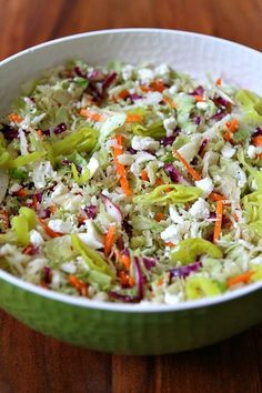Greek Style Cole Slaw: a lighter, non-mayo based coleslaw recipe with feta cheese and a lemon-oregano vinaigrette. Nutritional information and Weight Watcher's points included.