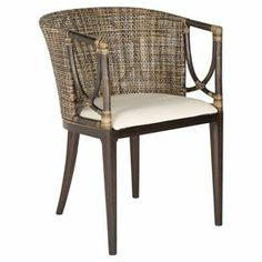 "Perfect pulled up to your dining table or writing desk, this chic arm chair showcases a woven back and tub-style silhouette.  Product: ChairConstruction Material: Mahogany and foamColor: Brown and blackFeatures:  Woven backTub-style silhouetteDimensions: 31.5"" H x 22.25"" W x 23.25"" D"
